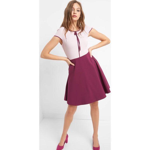 47dcffd98b5101 Rozkloszowana sukienka z kokardą - Sukienki . Za 139.99 zł ...